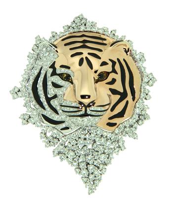 Anhänger/Brosche in 18 Karat Weiß- und Rotgold besetzt mit Diamanten (4,20 Karat), Augen gelber Saphir (0,65 Karat)